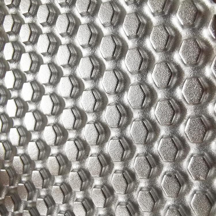 Non-woven steel to steel embossing roller